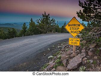 Narrow Steep Road Sign at Sunset