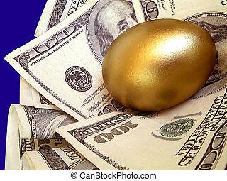 "Hundred dollar bills cuddle a golden ""nest egg"""
