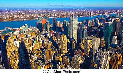 New York City skyline with urban skyscrapers at sunset. - Sn?mek