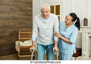 Nice aged man walking in the room
