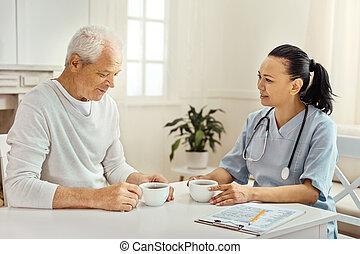 Nice elderly man telling his story