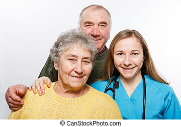 Nurse and elderly couple taking a selfie