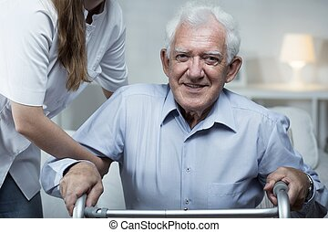 Nurse is helping elder man