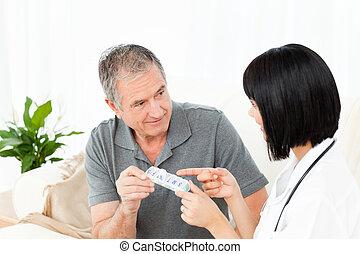 Nurse showing pills to her patient
