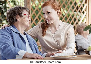 Nurse smiles to patient