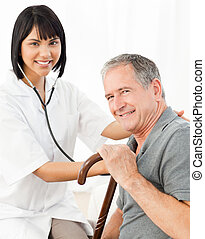 Nurse with her patient looking at the camera