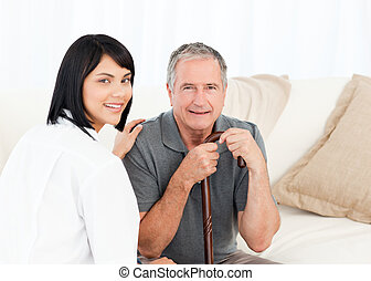 Nurse with her patient looking at t