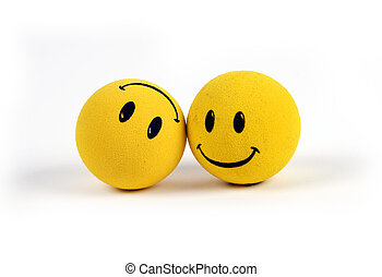 Two round smiley faces - one with a smile, one upside down with a frown.