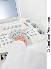 Obstetrician Using Ultrasound Machine