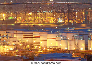 Oil tanks at night in container terminal