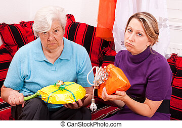 old and young woman are getting uninspired gifts