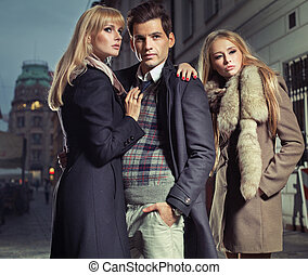 Old fashion man with company of two cute women