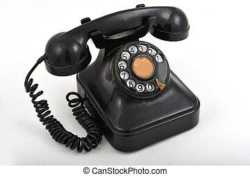 Black old style telephone on white background