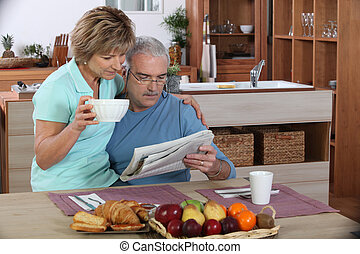 Older couple reading