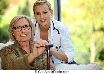 Older woman with a nurse