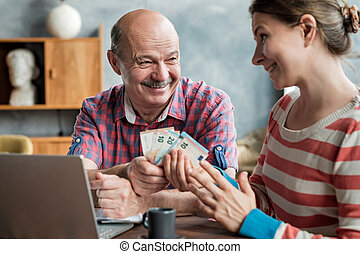 Olderly Spanish man gives his daughter money for a mortgage or student loan.