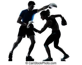 man woman boxing training silhouette