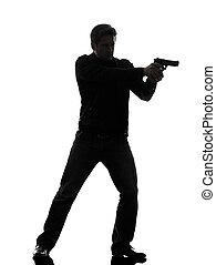 one man killer policeman aiming gun standing silhouette studio white background