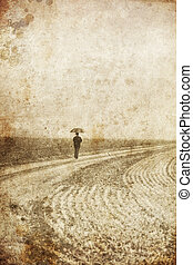 One person in for walking near field. Photo in old image style.