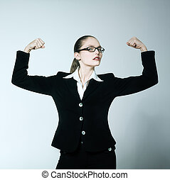 studio shot portrait of one caucasian young woman feeling strong