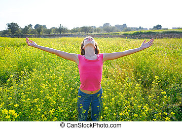 open arms happy teen girl in spring meadow