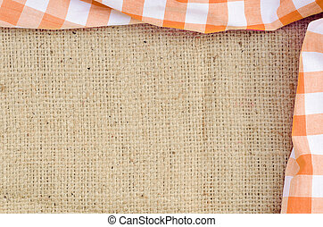 Orange folded checkered rural tablecloth over canvas - frame