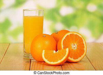 Orange juice on a wooden table