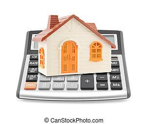 Orange toy house on calculator