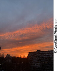Orange, yellow, pink and red sunset. Rooftop view