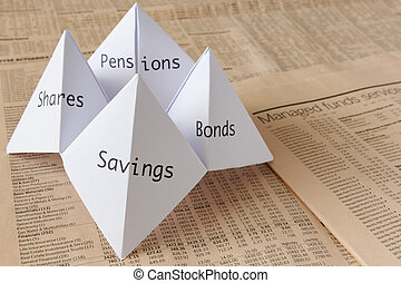 origami fortune teller on financial paper showing share prices