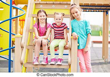 Active girls having fun on playground