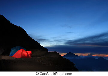 adventure outdoor camping by the mountain.
