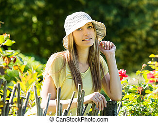 blonde woman near fence