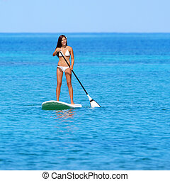 Paddleboarding beach woman on stand up paddleboard