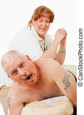 Humorous photo of a man surprised by a painful massage from an overly enthusiastic masseuse.