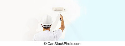 painter man at work with a paint roller isolated , web banner, wall painting concept