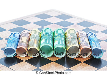 Paper money in the form of the euro on the chessboard. Concept Image.