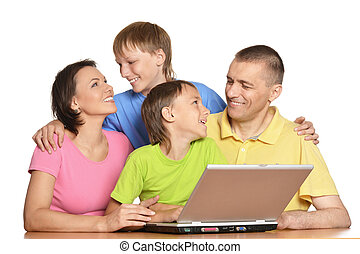 Parents with sons using laptop