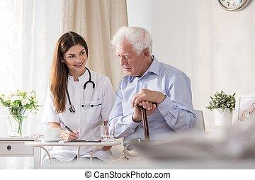 Patient talking to community nurse