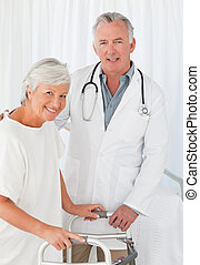 Patient with her doctor looking at the camera