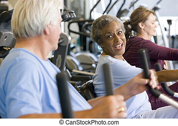 Patients Working Out In Gym