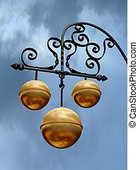 Pawnbroker shop sign with three golden balls