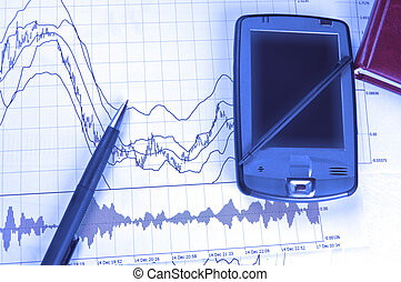 PDA and pen on Forex chart in blue lighting