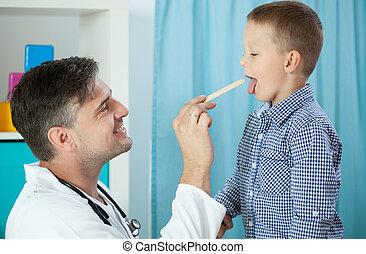 Pediatrician examining boy's throat