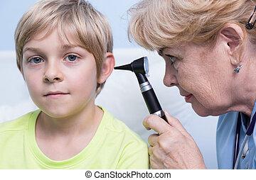 Pediatrician examining ear