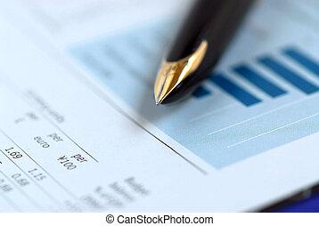 Golden fountain pen on financial chart