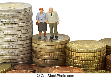 Figurine from senior couple with eruo coins on white background