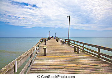 people enjoy fishing at the pier in Nags Head