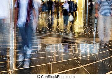 People walking thru the mall.