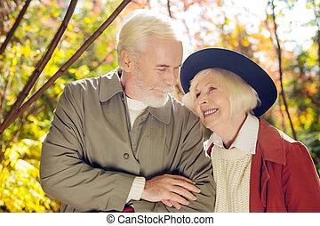 Joyful senior man looking at his wife